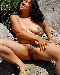 Exotic, mature, hippie strips to show her curves, large breasts, hairy bush and pits.